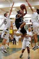 Rio Americano High School boys basketball playing against the El Camino Eagles