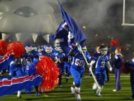Folsom Bulldogs running onto the field before their playoff game against Buhach Colony