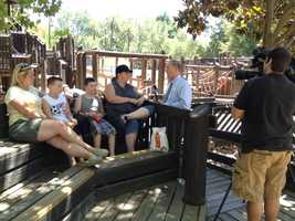 Tom DuHain conducts an interview at McKinley Park after a playground there was set on fire.