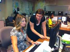 Executive producer Gretchen Littlejohn and producer Cate Kelly go over scripts in the KCRA newsroom.