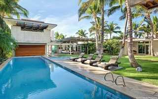 """Don't like the snow ... how about the beach? Say """"aloha"""" to 2013 at this tropical retreat in Maui. The property offers multiple open-air living spaces, a lushlylandscapedcourtyard with a 52-foot lap pool and access to beachfront walking paths."""