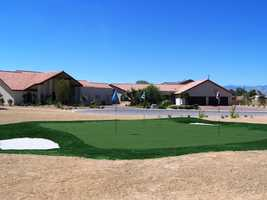 Las Vegas is notorious for throwing a great New Year's Eve party. Stay just minutes from the Strip at this Spanish-style oasis, which comes with its own private 3-hole golf course. This property can house up to 30 guests.