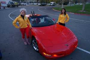 Tamara Berg and Jaclyn Dunn with Santa, and his new form of transportation, at the 2012 Chips for Kids.