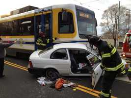 The driver of a car that was involved in a crash with a light-rail train Monday afternoon was taken to an area hospital.