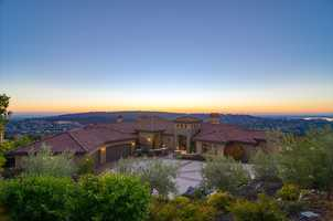 This home offers breath-taking views of Folsom Lake by day and sparkling city lights by night.