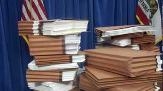 A pile of legal filings in the prison health care case. (Jan. 8, 2013)