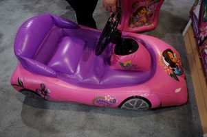 Kids can race in this iPad integrated inflatable car. The iPad goes on the steering wheel.