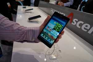 """Huawei, a Chinese smartphone manufacturer, showed off their latest """"phablet"""". A """"phablet"""" is a phone that is almost the size of a tablet. This one has a six-inch screen."""