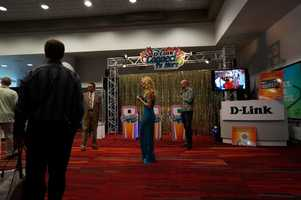 Booths tried just numerous approaches to get attendees to pay attention. This booth used a game show.
