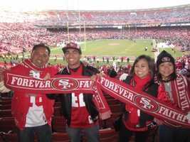 49ers fans pose atCandlestickPark.
