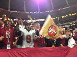 Fans from the field celebrate the 49ers win