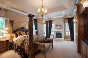 There are five bedrooms in the custom home.