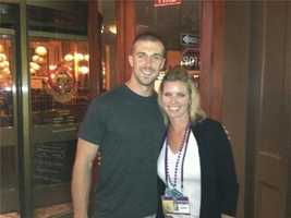 KCRA 3 anchor Kellie DeMarco stops for a photo with Niners quarterback Alex Smith (Jan. 28, 2013).