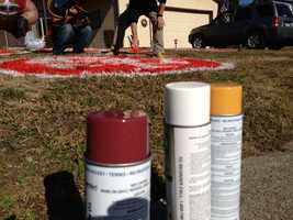 It takes two cans of red and white spray paint to create each logo.