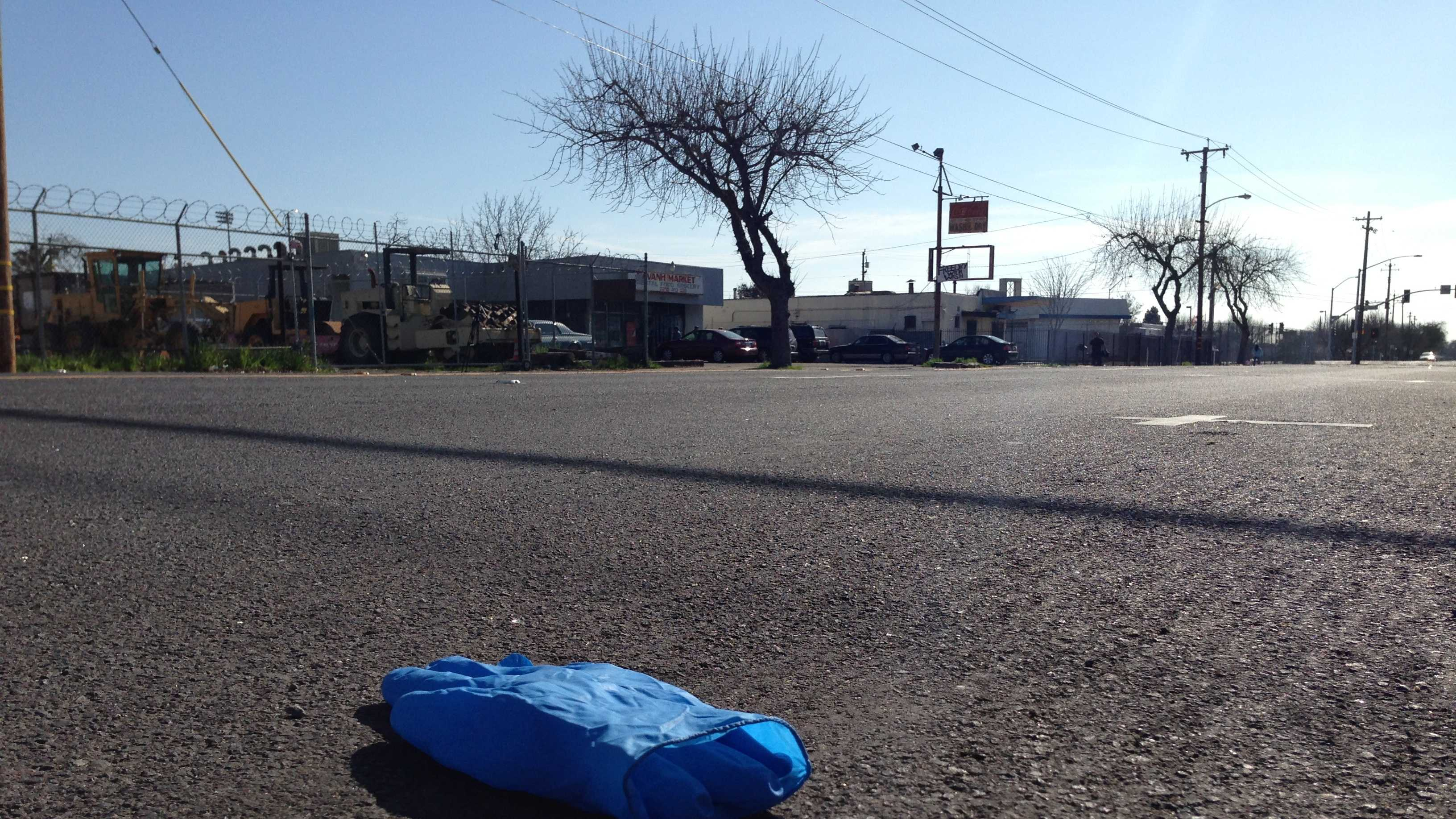 A paramedics glove lies on South Lincoln Street in Stockton, where police said a 34-year-old man was shot and killed early Sunday morning.