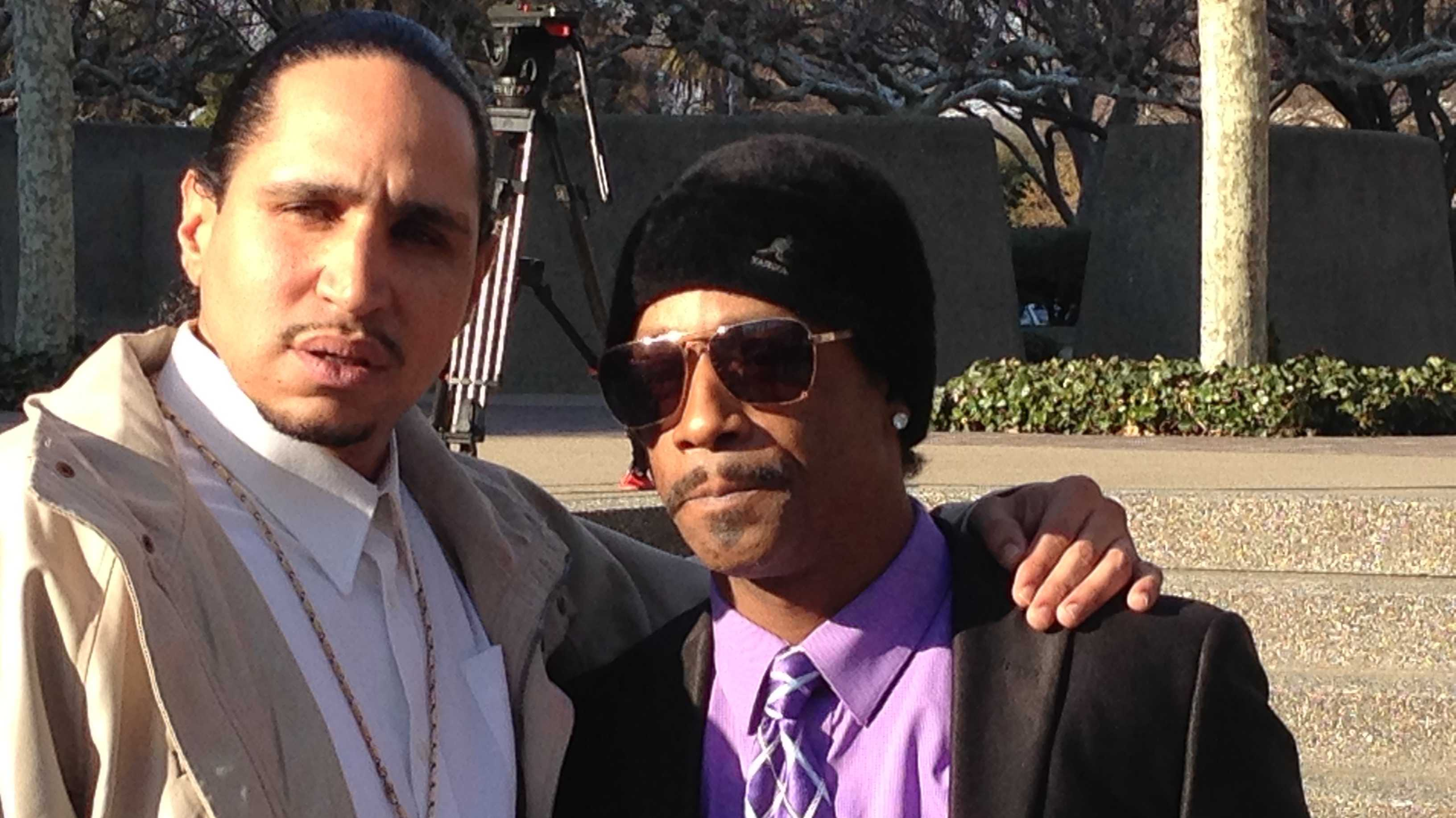 Katt Williams poses with an unidentified man outside the Sacramento County courthouse.