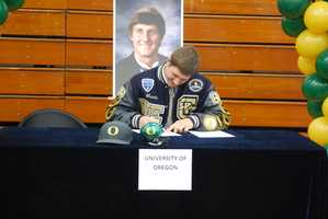 John Mundt, of Central Catholic High School, signed his letter of intent to play football at the University of Oregon.