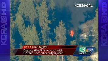Another view of a cabin on fire near the area of the search for ex-LAPD Officer Christopher Dorner.