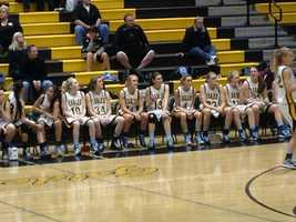 The Del Oro Lady Golden Eagles wait on their bench to take the court.