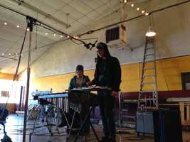 A keyboard player from Sun Country lays down a track for the group's latest recording.