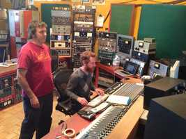 The Hangar Studio's owner, John Baccigaluppi, watches as an engineer records a track.