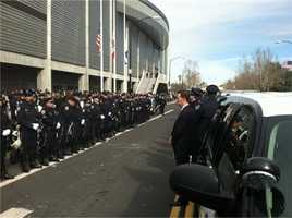 "Officers line up outside HP Pavilion in San Jose to honor officers Loran ""Butch"" Baker and Elizabeth Baker."