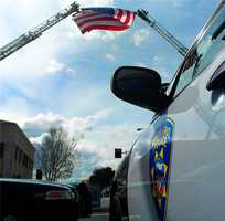 San Jose and Santa Cruz fire truck ladders holding an American flag.