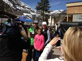 Travis Ganong poses with fans. (March 22, 2013)