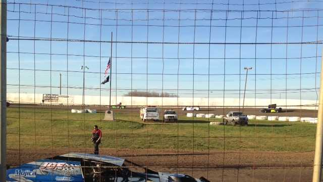 Races resume at Marysville Raceway Park around flag at half staff.