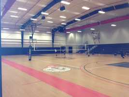 This NCAA gym holds three basketball courts, volleyball courts and wrestling mats.