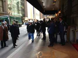 The media are lined up outside of the St. Regis in New York.