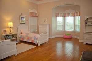 The home is situated on almost an acre flat lot with tremendous views of Folsom Lake. Here, a look inside the children's bedroom.
