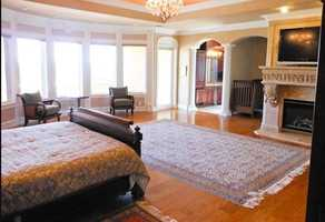 Here's another look of the home's large master bedroom.