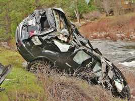 A kayaker came to the rescue of a family of five whose SUV crashed into the American River.