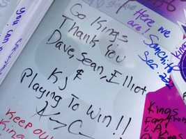 """Sacramento Kings fans sign the tour bus of """"Carmichael Dave,"""" which returned from a nationwide tour and made it to Sleep Train Arena on Wednesday, for what might be the team's final home game in California's capital city (April 17, 2013)."""