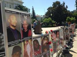 Families of crime victims speak out on the west steps of the state Capitol.