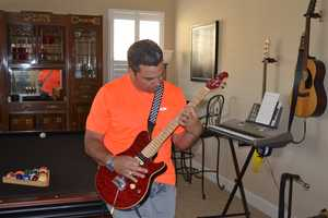 """4.) Rock on! Yes, that's me on guitar. I consider myself an """"accomplished average strummer."""" I could be your rhythm guitarist, but that's it. I think I'm trying to play a little Van Halen here. More on them later."""