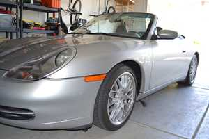 5.) I like cars. This is Mildred, my '99 Porsche 911. My kids named her after Arnold Schwarzenegger's mistress. They thought it was funny, and it stuck. Sometimes we impersonate 'Ah-nold' when we're riding in it. Aside from German cars, I'm a big fan of 1970s and '80s Ferraris. Perhaps my next project?