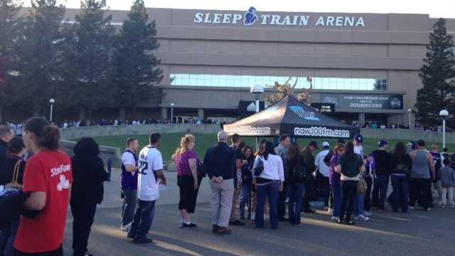 Fans walk up to Sleep Train Arena during the Kings final regular season game earlier this month.