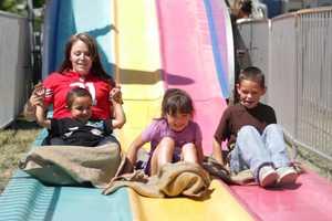 Enjoying the slide at Stockton Asparagus Festival