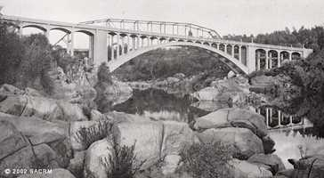 Then: A photo of the bridge from 1924 or 1925.