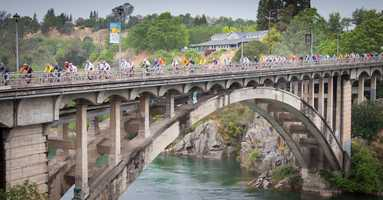 Now: Cyclists in the 2011 Amgen Tour of California cross the historic Rainbow Bridge in Folsom.