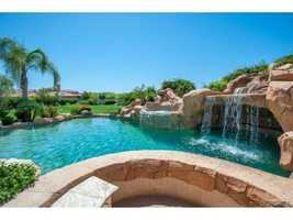 The crown jewel of this home is the pool, which wades into tranquil existence with a prime waterfall, water slide and swim-in grotto.