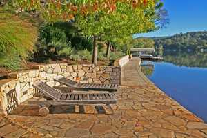 The home has expansive porcelain tile decking to enjoy views of the lake.