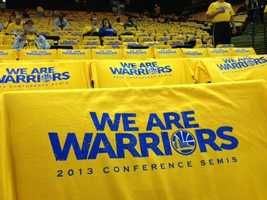 Warriors T-shirts fill the stands at Oracle Arena in Oakland.