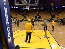 Players warm up before Game 6 between the Warriors and Spurs.