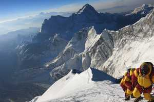 The climbers used bottled oxygen to aid their bodies and lungs in the extreme altitude. They also spent more than a month acclimatizing to the thin air before attempting the summit.
