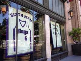 Chris Webber and Sixth Man jerseys hang in the windows at the Citizen Hotel, located across the street from Cesar Chavez Plaza. (May 23, 2012)