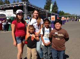 Children and other attendees enjoy the kickoff weekend to the Sacramento County Fair Friday at Cal Expo. Nearly 100,000 visitors are expected to attend this holiday weekend.