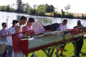 Ceres' junior team members Tyler Osborn, Ethan Cefre, Alex Villegas, Lance Goblirsch, Ethan Campbell and Ruben Rosalez prepare their boat for the water at SMUD's Solar Regatta.